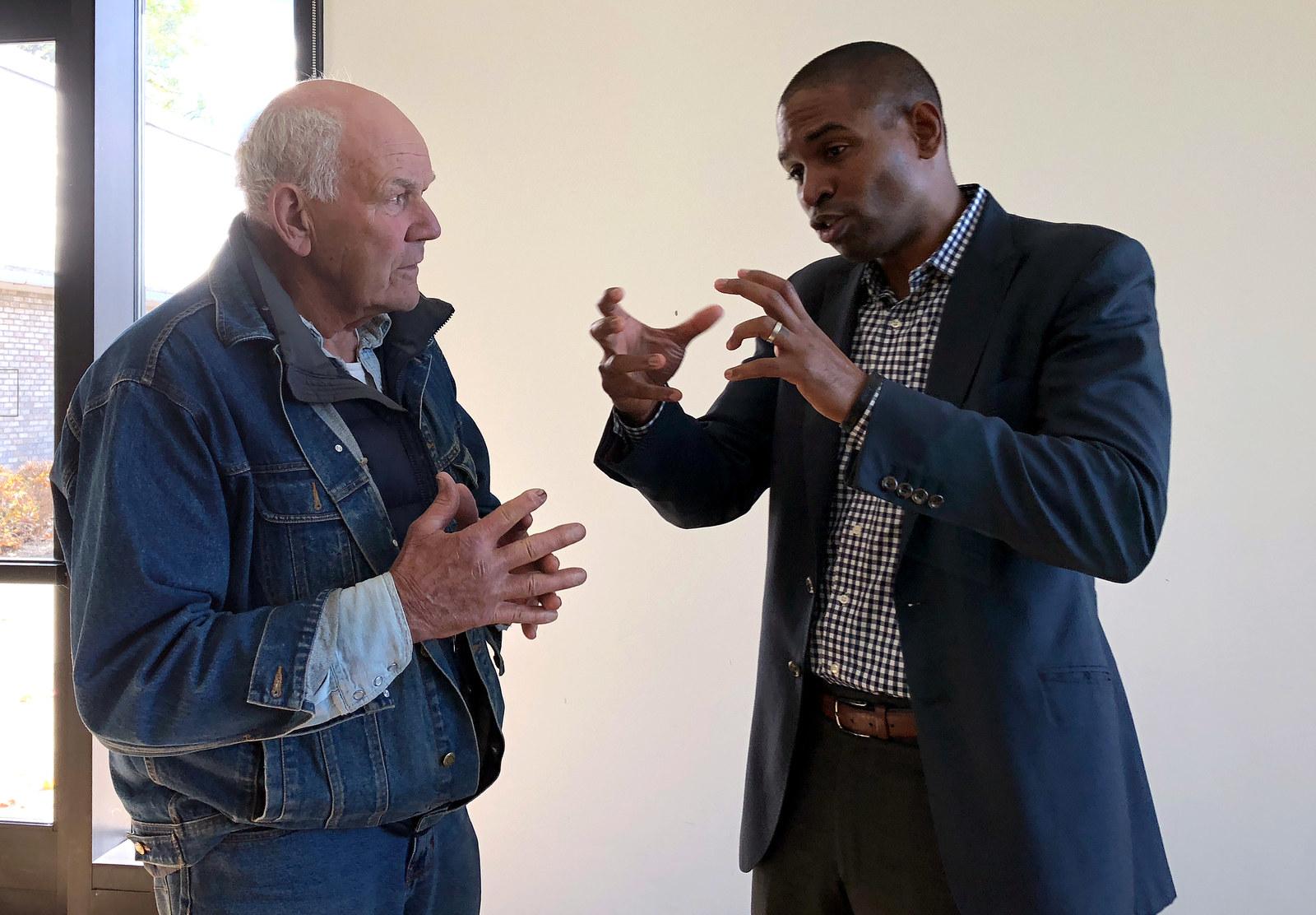 Antonio Delgado (right) talks to a voter following a campaign even in Canajoharie, New York, Oct. 20.