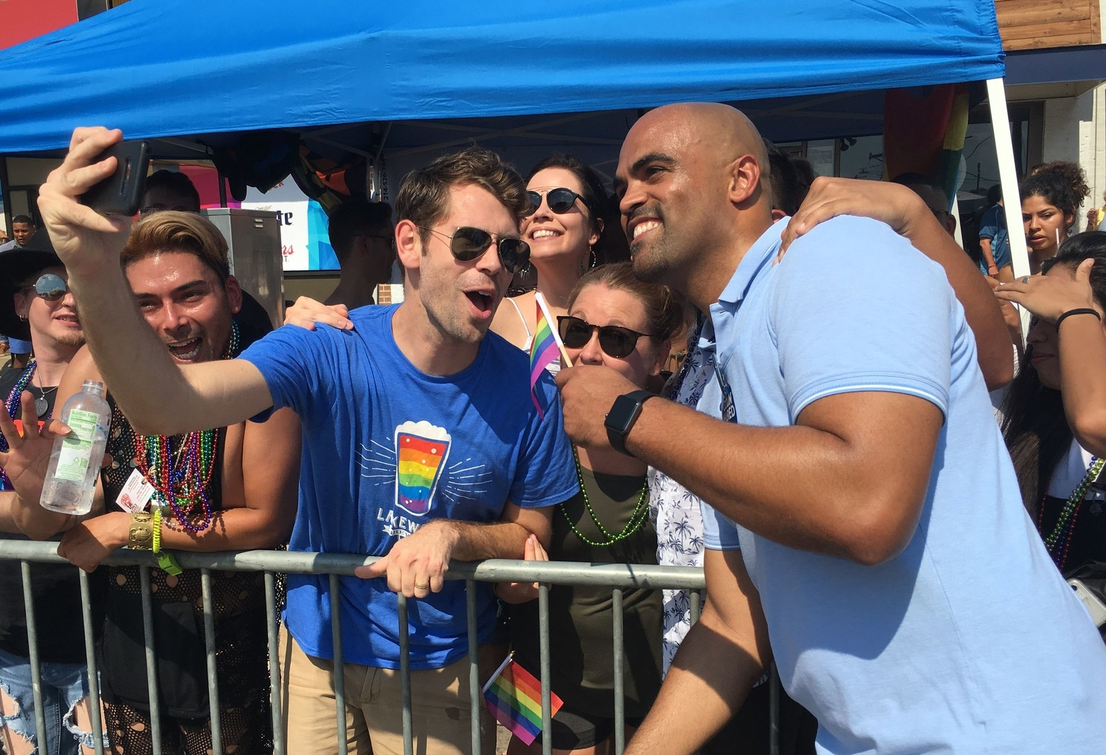 Colin Allred (right) with supporters as he marches in the Dallas Pride Parade on Sept. 16.