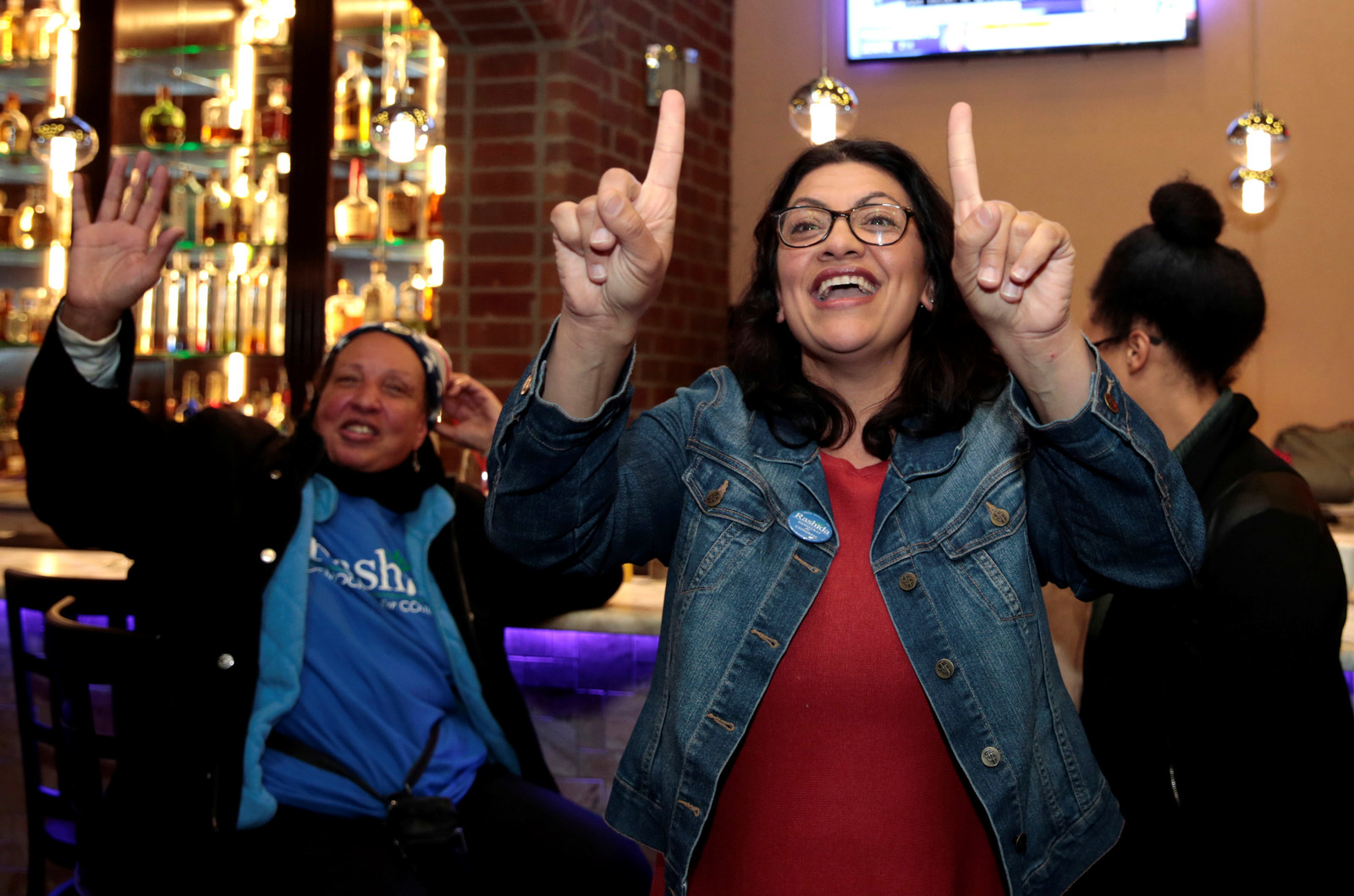 Rashida Tlaib celebrates with family and friends at her midterm election night party in Detroit, Nov. 6, 2018.