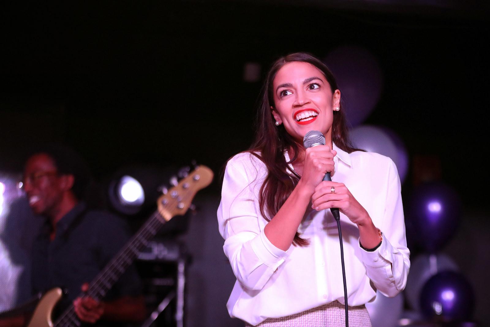 Alexandria Ocasio-Cortez addresses the crowd gathered at La Boom night club in Queens on Nov. 6, 2018, in New York City.