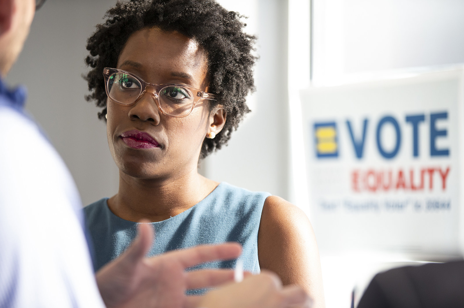 Lauren Underwood talks with the president of the Human Rights Campaign on Oct. 3, 2018, in Geneva, Illinois.