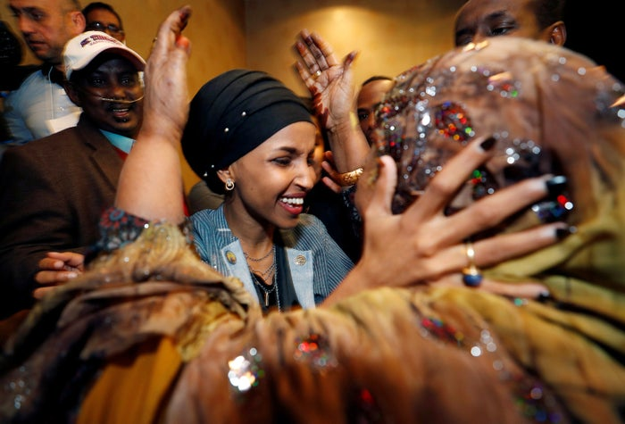 Ilhan Omar, the first Somali American Muslim woman elected to Congress, embraces a family member at her election party in Minneapolis.