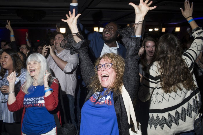 The crowd at the Democratic Congressional Campaign Committee watch party celebrate the news that Democrats gained majority control of the House, in Washington, DC.