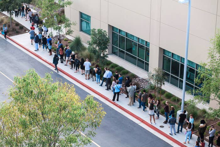 People wait in line to cast their ballot at a polling station in San Diego.
