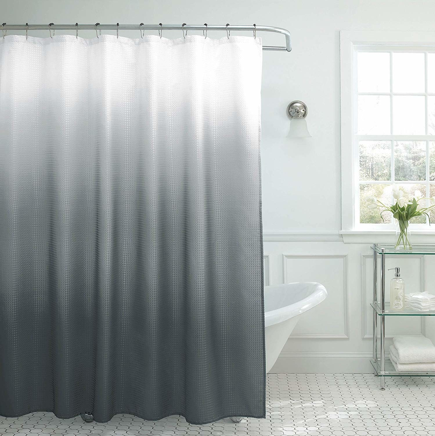 Gray ombre curtains hanging in bathroom