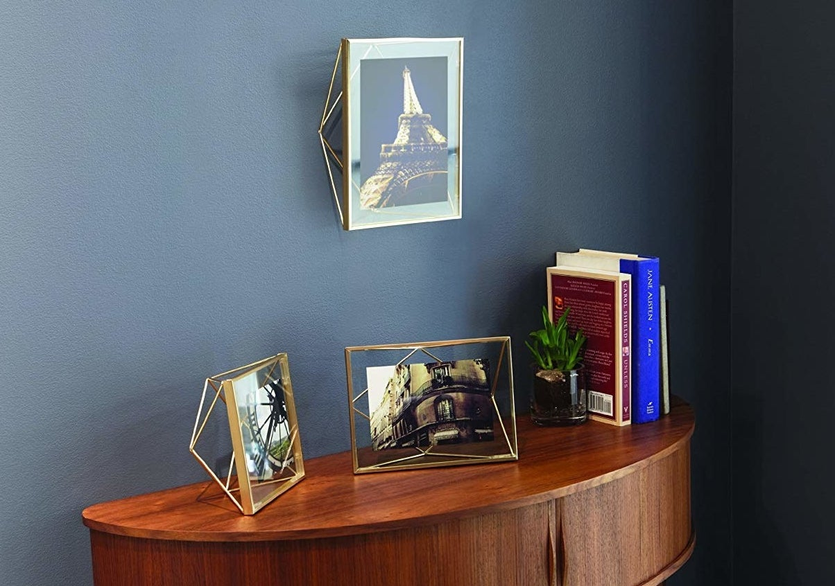 Photo frames on table next to books