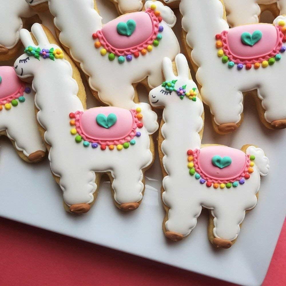 freshly baked cookies in the shape of colorful alpacas