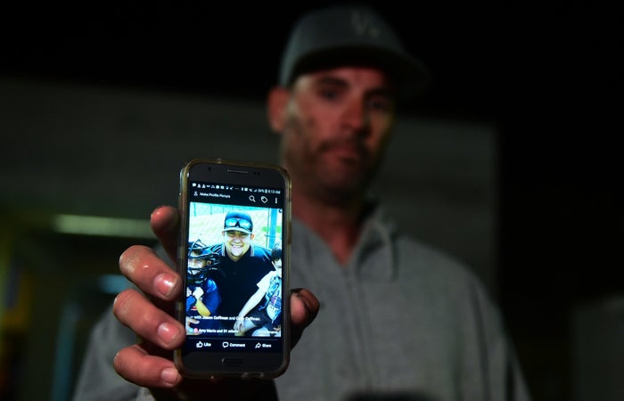 Jason Coffman displays a photo of his son Cody.