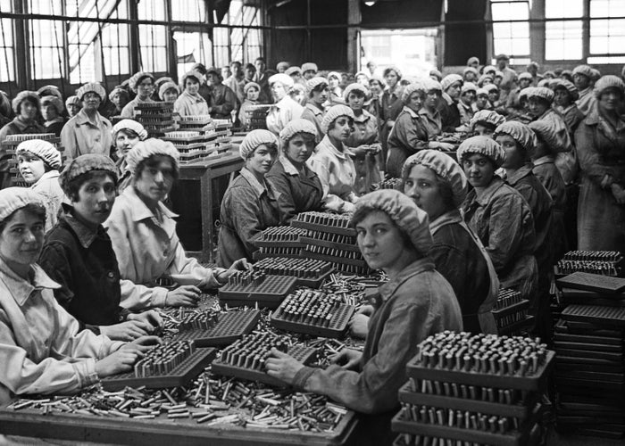 Munition workers finish small-arms cartridges at the Woolwich Arsenal in London, 1918.
