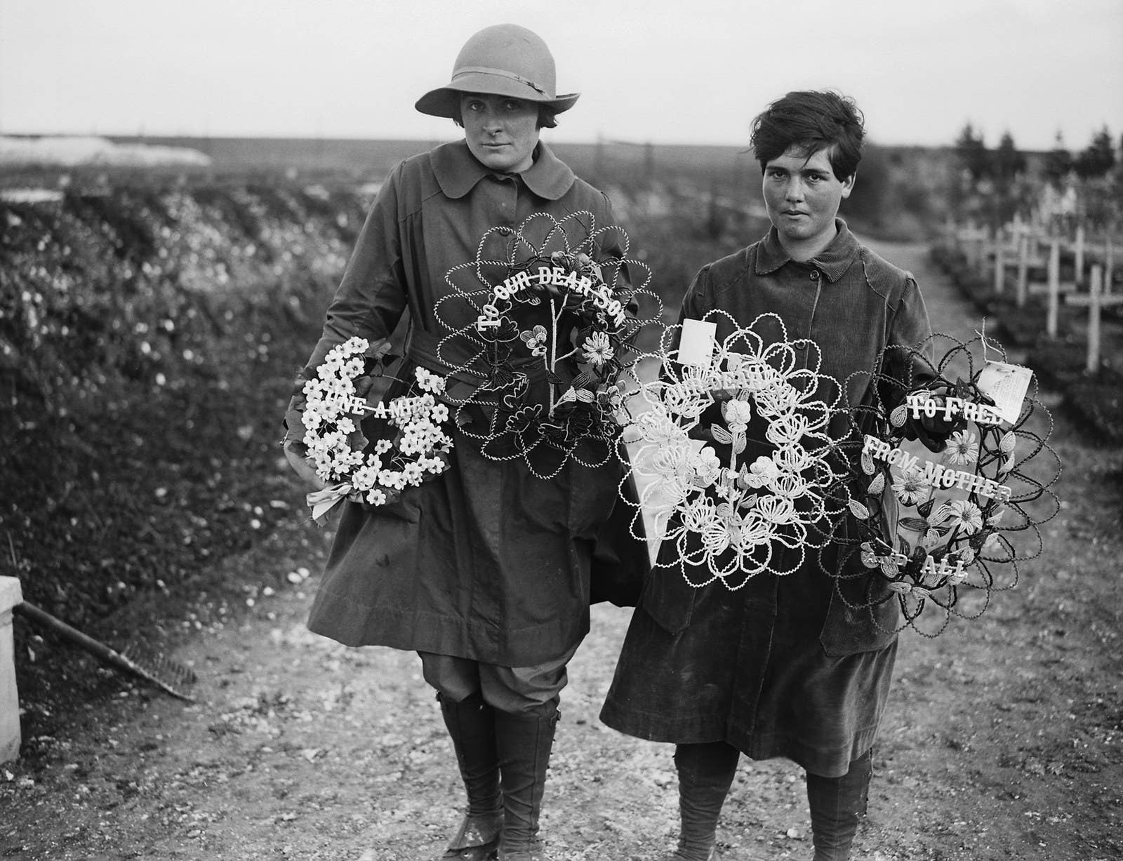 Two members of the Women's Auxiliary Army Corps carrying wreaths to place on the graves of British soldiers buried at Abbeville, France, 1918.