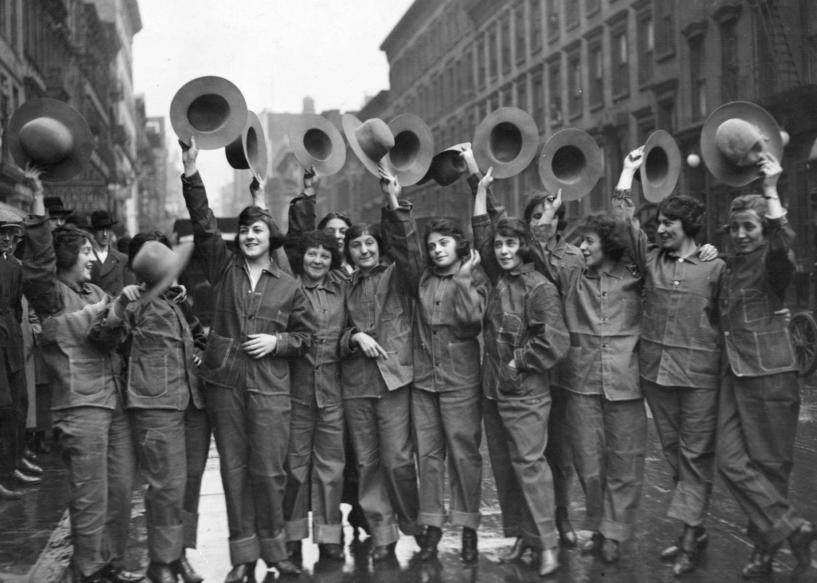 Women parade in their military uniforms in New York City, circa 1918.