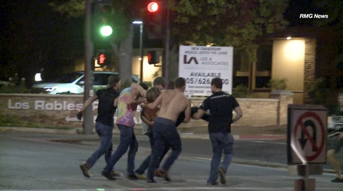 A victim is carried from the scene of the shooting Nov. 7, 2018, in Thousand Oaks.