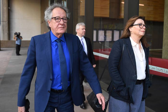 Geoffrey Rush arrives with his wife Jane Menelaus on the final day of his defamation trial in Sydney.