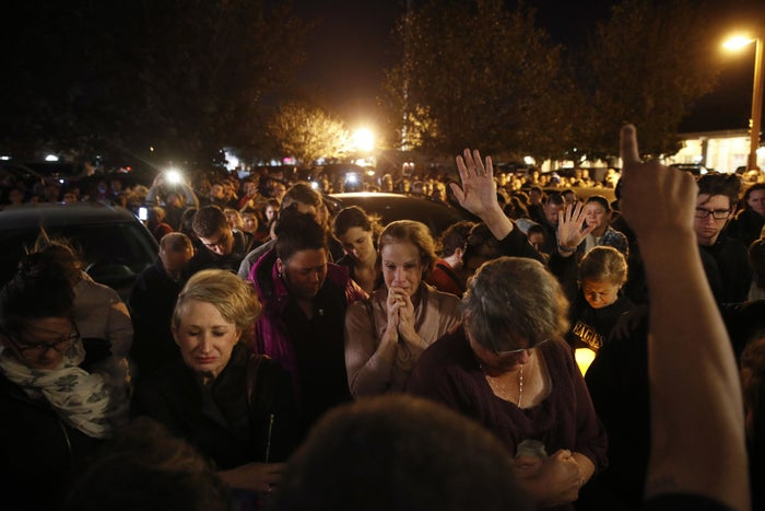 People gather outside the Rivalry Roasters coffee shop for a vigil for Sean Adler in Simi Valley, California.