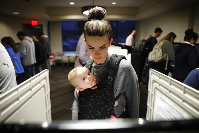 Kristen Leach votes with her 6-month-old daughter, Nora, on Election Day, Nov. 6, in Atlanta.