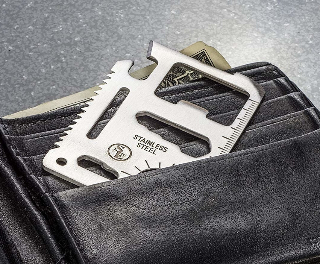 silver multitool tucked into a wallet