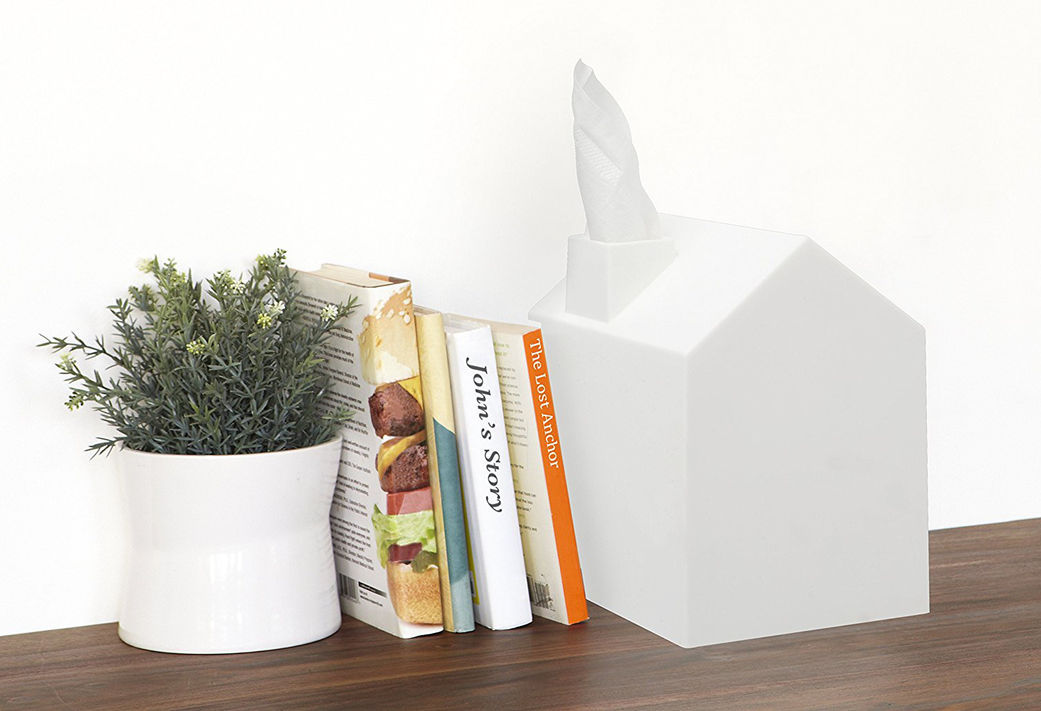 Tissue box on table next to books