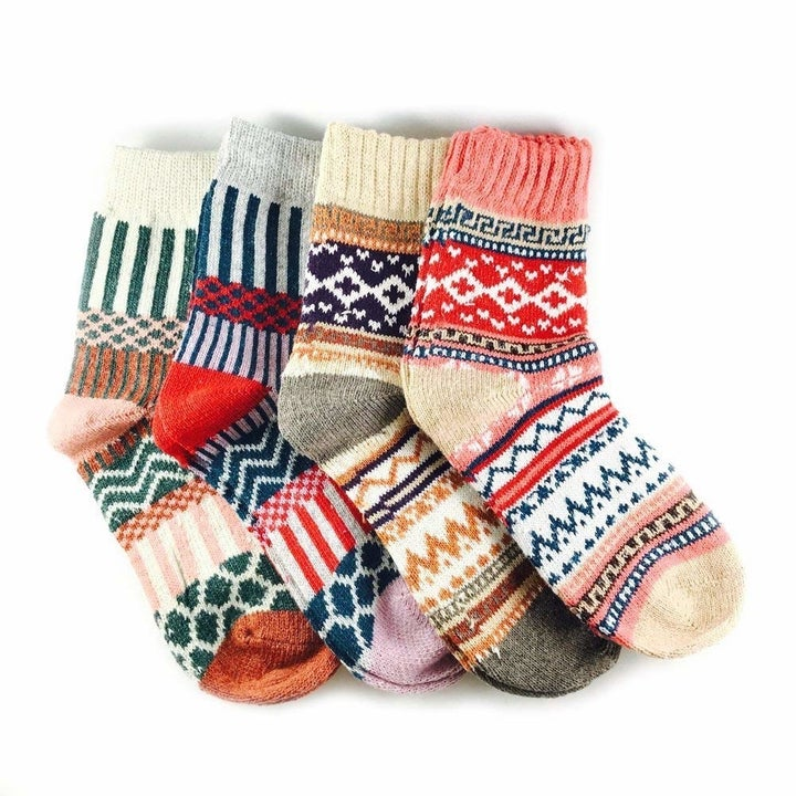 four socks in different sweater-style prints