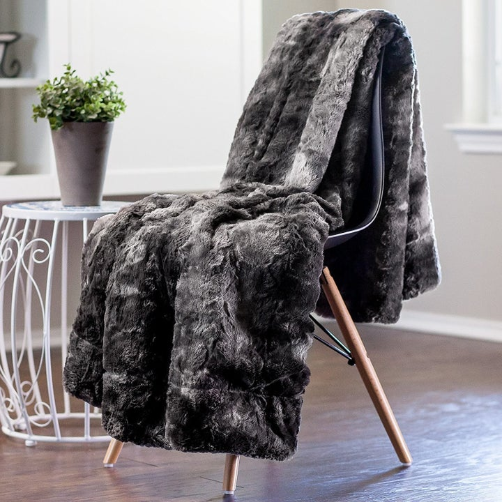 the faux fur blanket draped over a chair