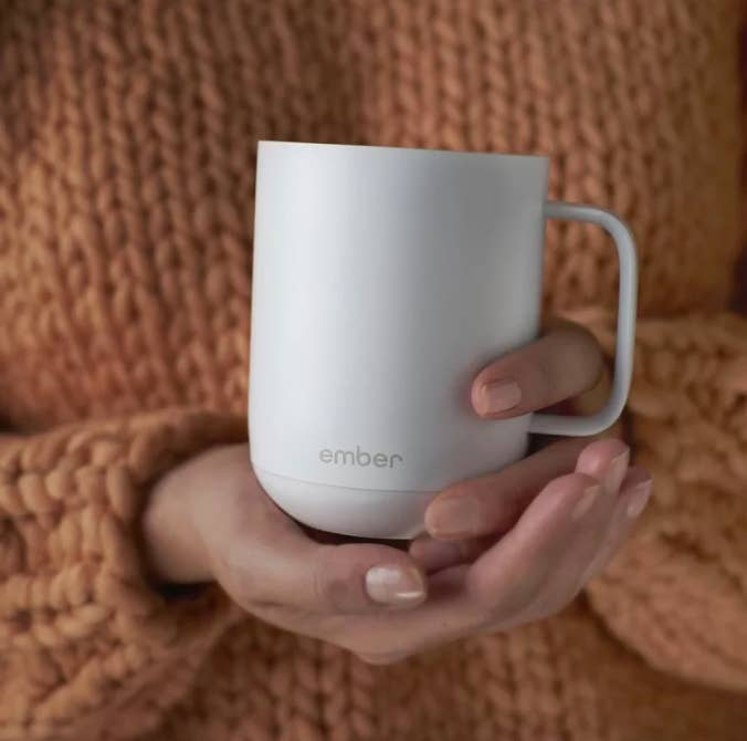 """Promising review: """"This thing is my new best friend. I never realized how bad drinking lukewarm or cold coffee was until I bought the Ember. I've been waiting for years to get one because it was always too expensive. But the price dropped significantly recently, so I took advantage. Let me tell you: I'll never go back to a regular ceramic mug. I drink about half a pot of coffee every morning, which takes about two hours, and didn't realize that I was drinking cold coffee about half an hour in. It's so odd to have every sip of coffee be the perfect temperature, but I love it! The ceramic is a bit thinner than your standard mug and the bottom is thicker, I'm assuming to hold the electronics of the mug, so that takes a bit of getting used to."""" —Kyle Switala Price: $79.95 (available in black and white)"""