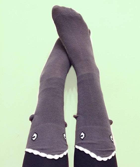 the knee high socks that look like a shark eating your leg