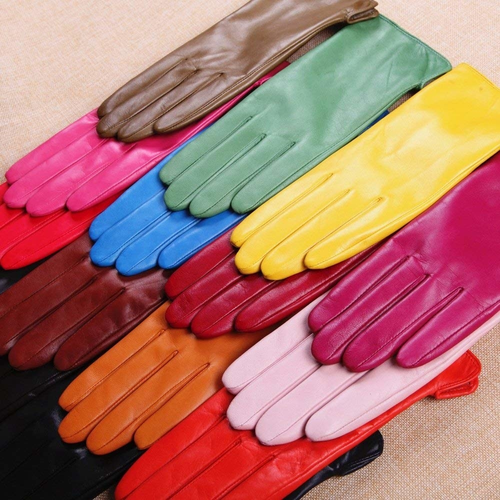 The gloves in colors like yellow, pink, red, brown, and blue