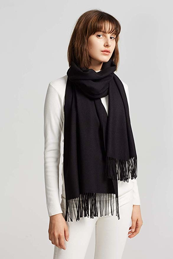 model wearing the black scarf with fringe at ends