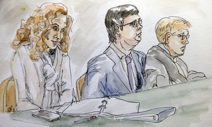 A courtroom sketch James Alex Fields Jr. (center) with his attorneys in court.