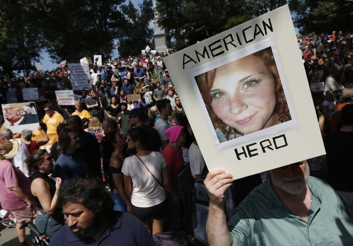 A counterprotester holds a photo of Heather Heyer in 2017.