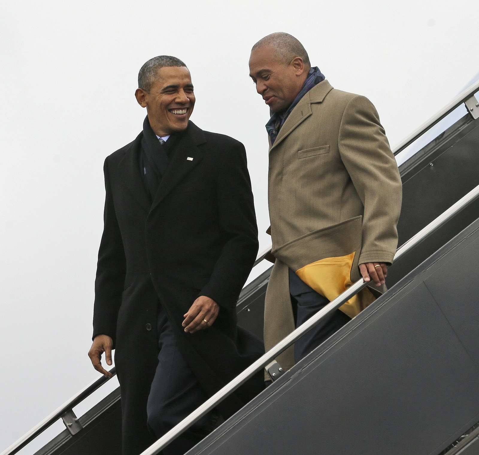 Barack Obama leaving Air Force One with Patrick, March 5, 2014.