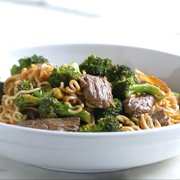 Servings: 4INGREDIENTS3 3-ounce packages instant ramen8 cups boiling water1 clove garlic, minced1 teaspoon cornstarch2 tablespoons sesame oilJuice of 1 lime¼ cup plus 1 tablespoon soy sauce2 cups broccoli florets1 tablespoon olive oil, divided¾ pound flank steak, thinly sliced½ medium yellow onion, thinly sliced Garnishes (optional):2 tablespoons sliced green onions2 tablespoons chopped fresh cilantro1½ teaspoons toasted sesame seedsPREPARATION1. Place the ramen noodles in a large bowl (discard the seasoning packets or save for another use) and pour the boiling water over them. Let sit for 6 minutes, stirring every now and then to break up the noodle blocks. Drain and rinse under cold water. Set aside.2. In a small bowl, combine the garlic, cornstarch, sesame oil, lime juice, and soy sauce. Stir well, then set aside.3. Place the broccoli in a large, microwave-safe bowl and microwave for 1½ minutes, until soft. Set aside.4. Heat 1 teaspoon of olive oil in a large, nonstick pan over high heat. Add the steak to the pan and toss with 2 tablespoons of the reserved sauce. Cook until browned, about 2 minutes. Remove from the pan and set aside.5. Heat another teaspoon of olive oil in the pan, then add the onion. Cook, stirring often, until browned, about 4 minutes. 6. Add the broccoli and cook until lightly browned, about 2 minutes. Remove from the pan and set aside.6. Add the remaining teaspoon of olive oil to the pan, then add the noodles and the remaining sauce. Cook, stirring constantly, until the noodles soak up the sauce. Return the cooked vegetables and steak to the pan and stir to distribute.7. Transfer the noodles to a serving dish and garnish with green onions, cilantro, and sesame seeds, if using.8. Enjoy!Note: Make sure to use a large nonstick pan when frying the noodles to avoid sticking. If using a low-sodium soy sauce, feel free to season noodles with kosher salt.*Vegan/Vegetarian Substitution: Omit the steak and replace with tofu, edamame, or scrambled eggs for additional protein.