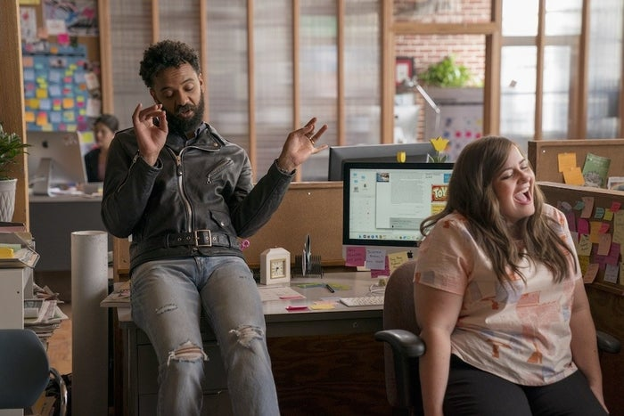 Annie and her coworker Amadi (Ian Owens) in Episode 2.