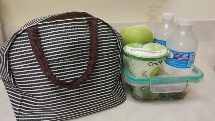 """It has an insulated interior so your food will stay hot or cold for up to four hours.Promising review: """"When I first received it, I thought I was going to return it because it looked too small. I was totally wrong. My entire lunch, snacks, and even protein shake bottle fit perfectly! I even have extra space left in the front pocket."""" —SamanthaGet it from Amazon for $13.99."""