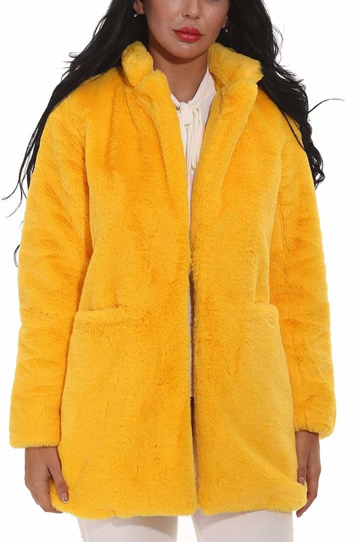 206fe685 A yellow faux fur coat that's giving me