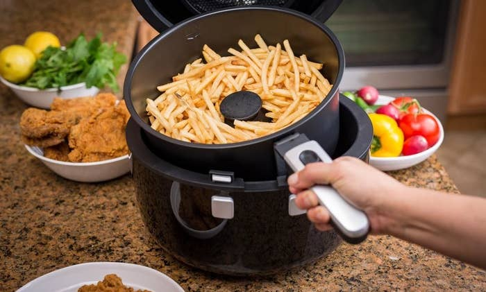 Features a stir accessory that will automatically gently mix food to ensure even cooking results. The basket is durable and non-stick Teon coated and has a built-in handle to make pulling food out of the fryer and transferring to dishes easy. The fryer also has easy-to-use touch activated controls for adjusting temps and cook times, and a transparent window so they can see how their food is cooking.Price: $84.88 (originally $149)