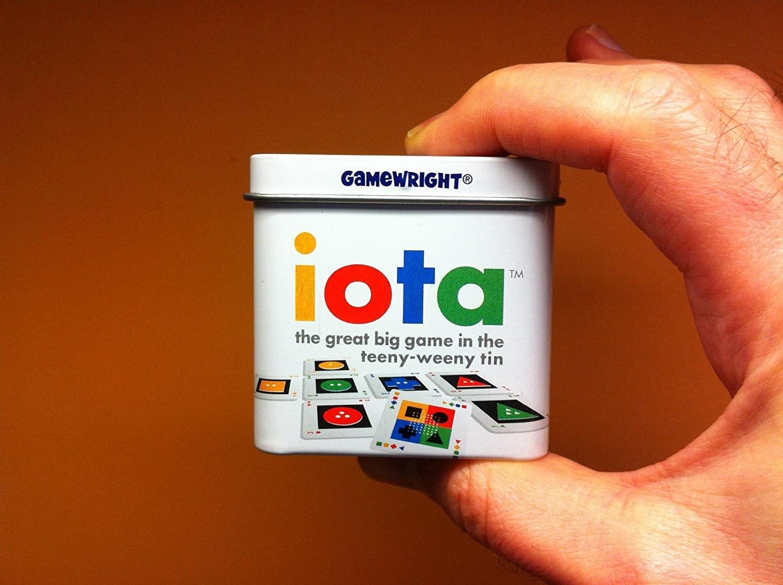 hand holds small tin that says iota