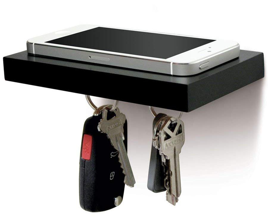 Minimalist black floating shelf with keys attached