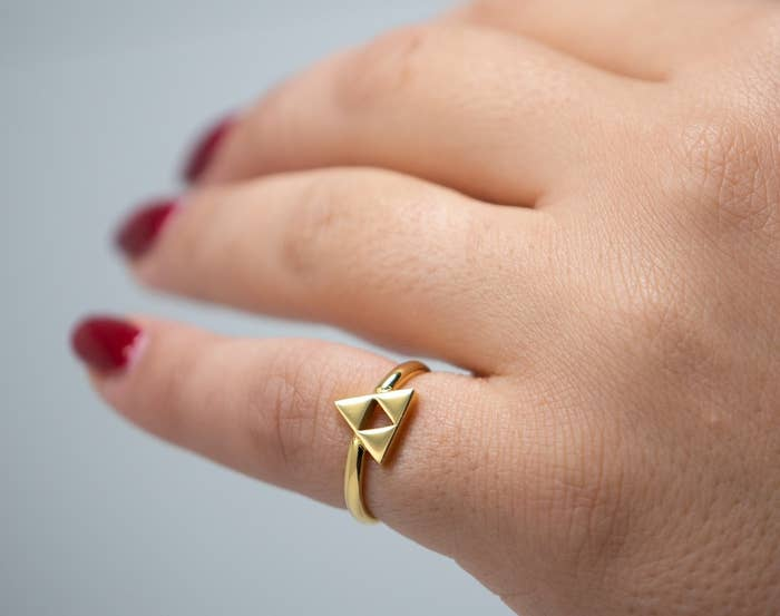 a dainty gold triforce ring