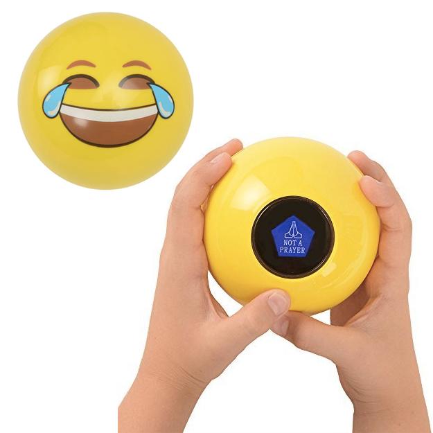 hand holds laughing emoji ball