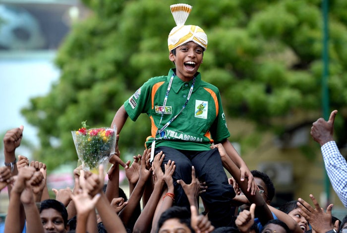 Indian chess prodigy Rameshbabu Praggnanandhaa, 12, is celebrated by his friends upon arrival back to his school in Chennai, India, on June 26, after becoming the world's second youngest chess grandmaster ever.