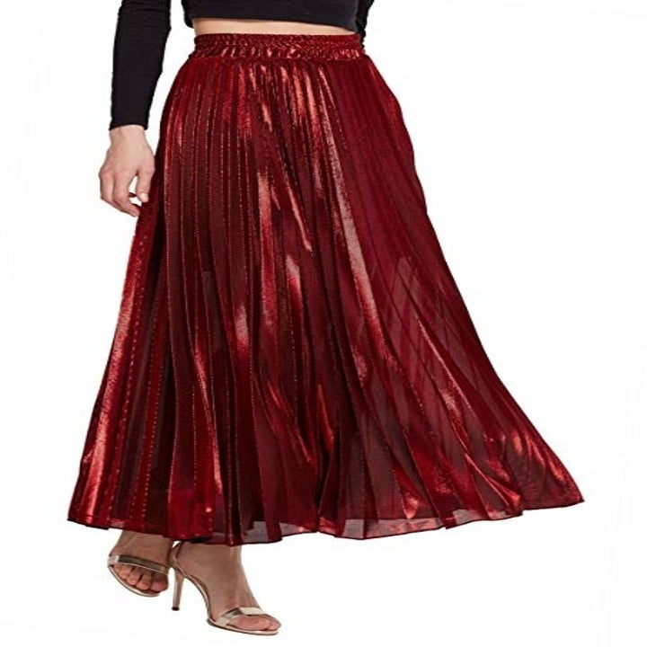 model wearing red metallic midi dress