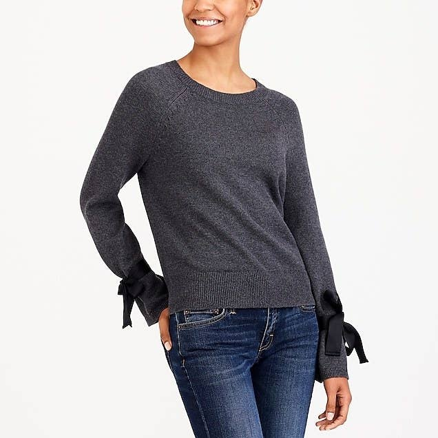 "Promising review: ""This is a cute statement top for fall and winter. I bought this in both colors because I loved it so much! The sleeves seem large until you tie the bow — and then it's perfect!"" —jcrewfan1Get it from J.Crew Factory for $19.50 (available in sizes XXS-3X and in gray and beige)."