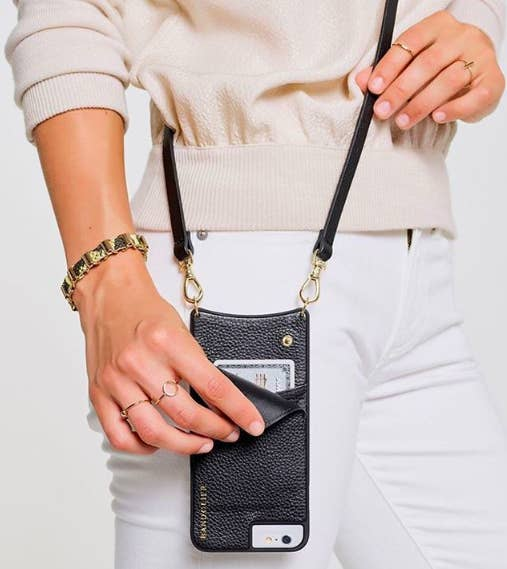 c2a937d7c562 This sleek phone case holds multiple cards and comes with a strap so you  can wear your phone like a crossbody bag.