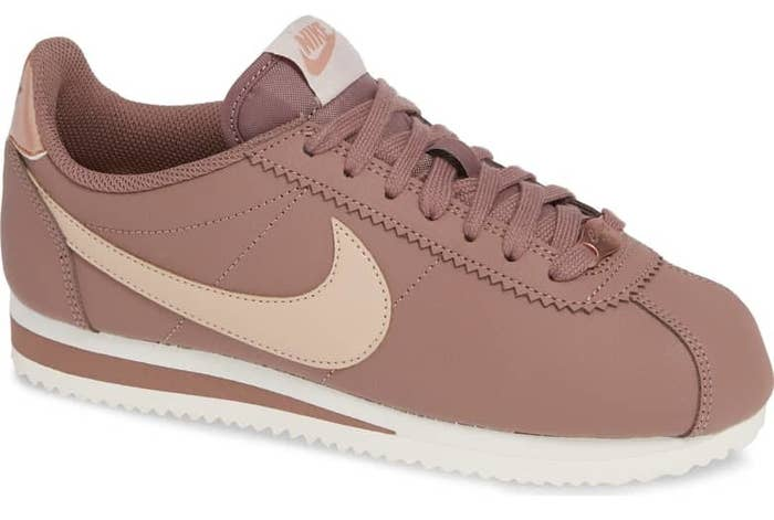 the latest b3fb3 159a3 A pair of classic Nike Cortez sneakers with all the details in pink — these  are, by far, the best freakin sneakers in the world and now theyre in  pink, ...