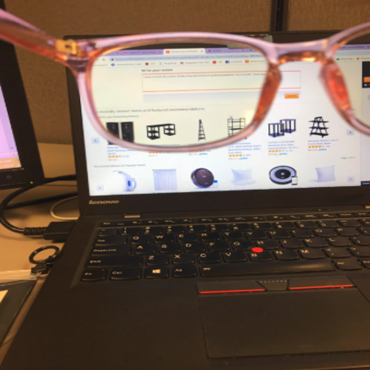 a reviewer photo showing how the glasses prevent eye strain