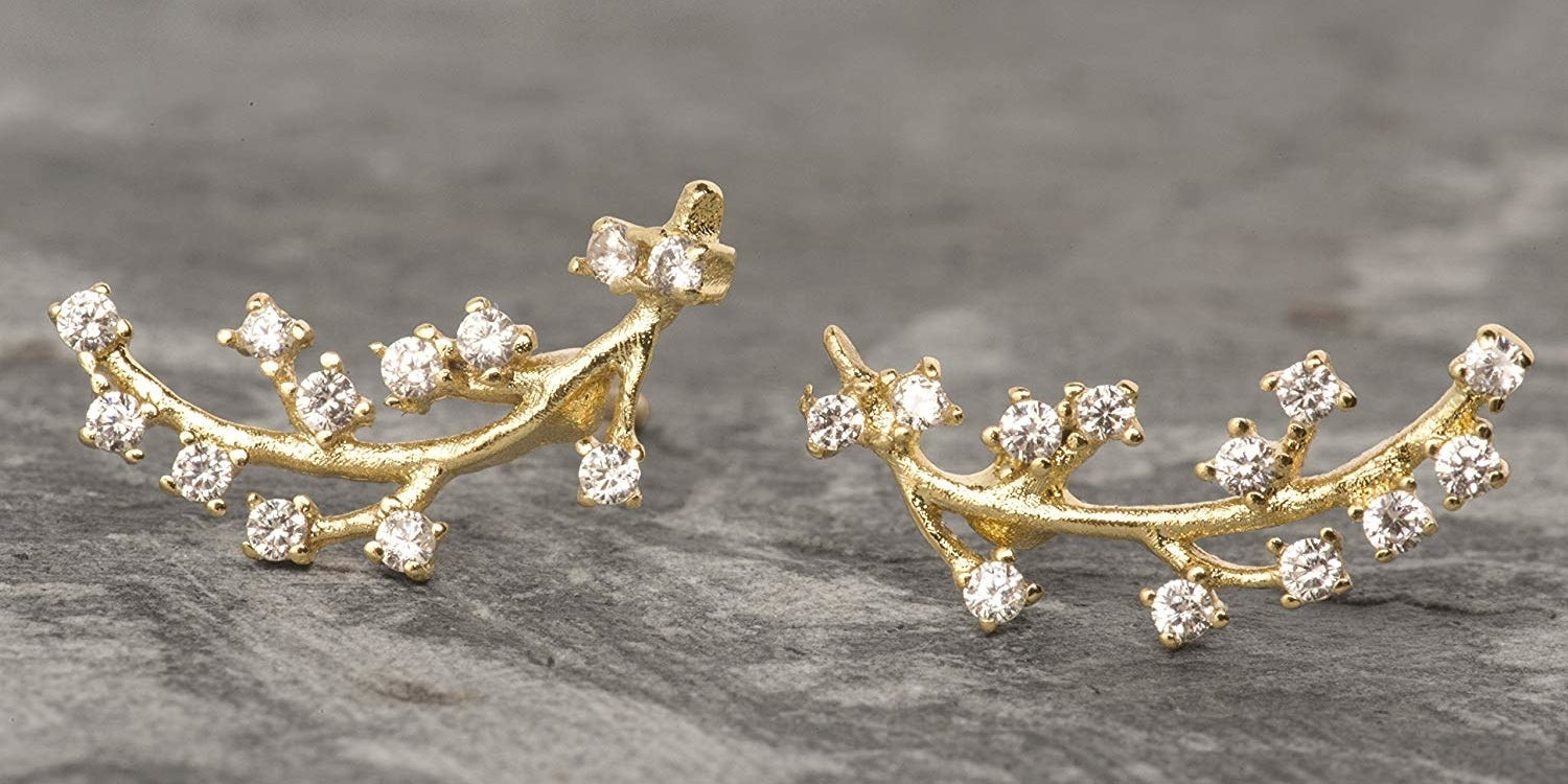 The branch-like earrings with rhinestones at the end of each branch