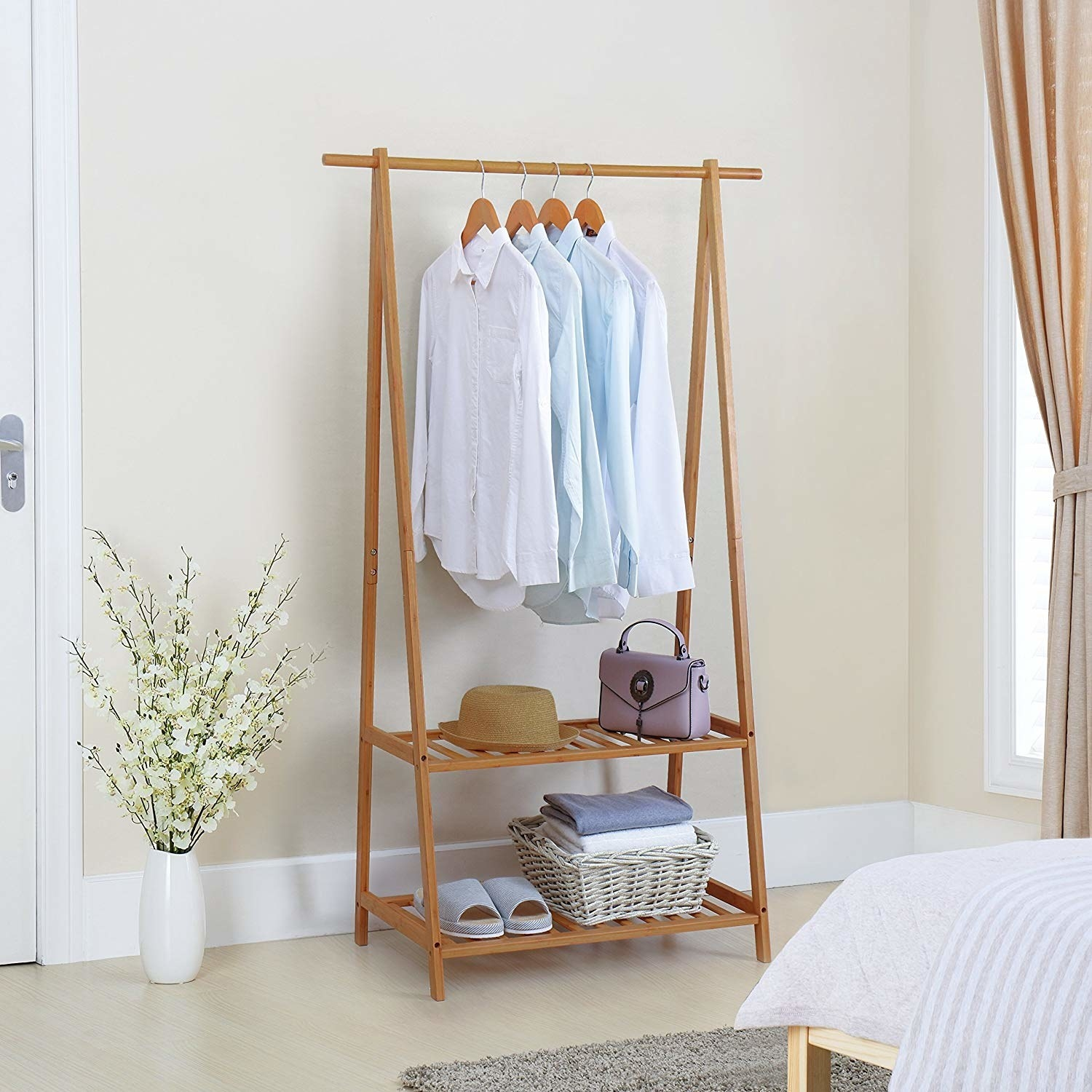 The tan garment rack with two slotted shelves on the bottom for accessories