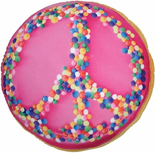 donut-shape pillow with sprinkle look on it