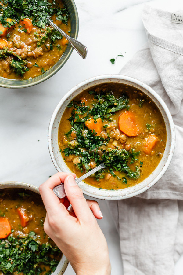 Weeknight Slow Cooker Lentil Soup  -  Two types of lentils and a plethora of veggies make this soup both hearty and healthy. Get the recipe .