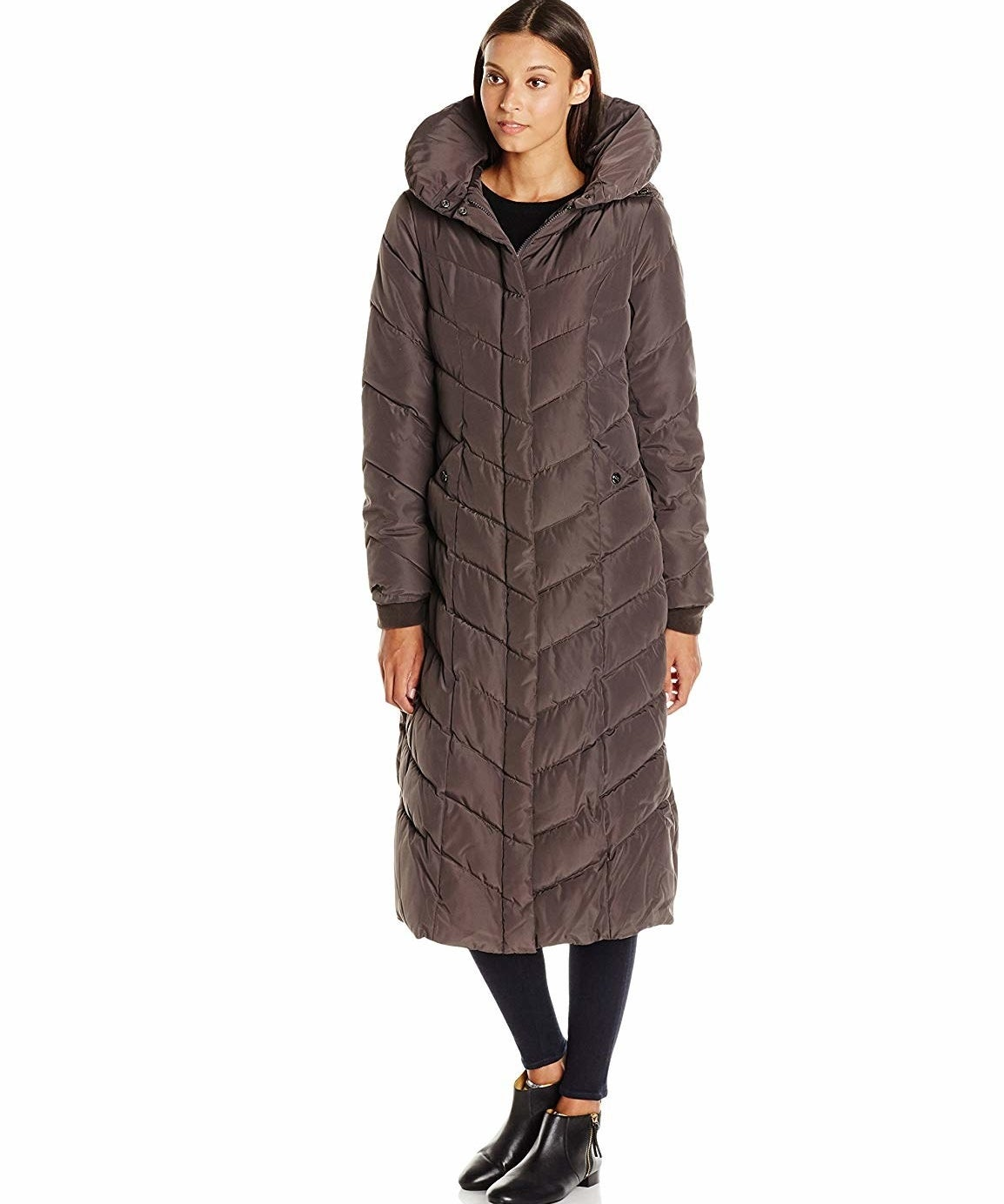 """Promising review: """"Though the fit is a little tight, (if you're between sizes, DO order up a size), the coat is flat out lovely and tremendously WARM! The puffy collar keeps your neck warm, even if you don't have the hood up. The hood fits snugly around your head, so blowing wind doesn't really affect how warm you stay. I HIGHLY recommend this coat."""" —Amazon CustomerPrice: $71.99+ (available in two colors, and sizes S–XL)"""